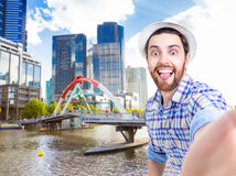 Happy young man taking a selfie photo in Melbourne, Australia Stock Images