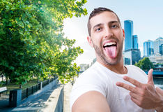 Happy young man taking a selfie photo in Melbourne, Australia Royalty Free Stock Image