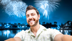Happy young man taking a selfie photo in the New years eve Royalty Free Stock Images