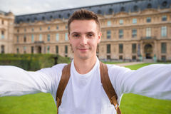 Happy young man taking a selfie photo in Paris. Happy young man taking selfie in Paris Royalty Free Stock Images