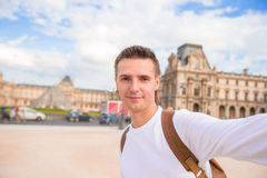 Happy young man taking a selfie photo in Paris. Happy young man taking selfie in Paris Royalty Free Stock Photography