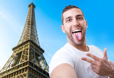 Happy young man taking a selfie photo in Paris, France.  Royalty Free Stock Photo