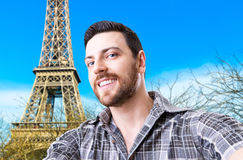 Happy young man taking a selfie photo in Paris, France.  Royalty Free Stock Photography