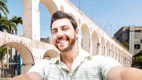 Happy young man taking a selfie photo in Rio de Janeiro, Brazil Stock Photos