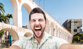 Happy young man taking a selfie photo in Rio de Janeiro, Brazil Royalty Free Stock Image