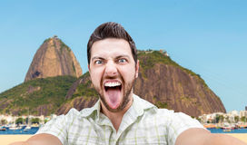 Happy young man taking a selfie photo in Rio de Janeiro, Brazil Royalty Free Stock Photography
