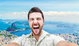 Happy young man taking a selfie photo in Rio de Janeiro, Brazil Stock Image