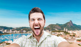 Happy young man taking a selfie photo in Rio de Janeiro, Brazil Stock Photography