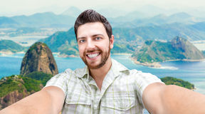 Happy young man taking a selfie photo in Rio de Janeiro, Brazil Royalty Free Stock Photo