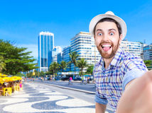 Happy young man taking a selfie photo in Rio de Janeiro, Brazil Stock Photo