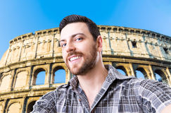 Happy young man taking a selfie photo in Rome, Italy Stock Photo