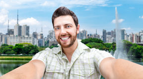 Happy young man taking a selfie photo in Sao Paulo, Brazil Stock Image