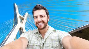 Happy young man taking a selfie photo in Sao Paulo, Brazil Stock Images
