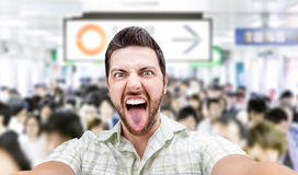 Happy young man taking a selfie photo in Tokyo, Japan Stock Images