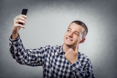 Happy young man taking a selfie Stock Images