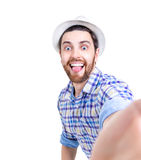 Happy young man taking a selfie photo on white background Stock Images