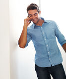 Happy young man talking on cellphone Stock Photos