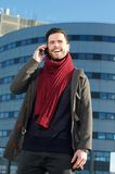 Happy young man talking on cellphone in the city Royalty Free Stock Photos