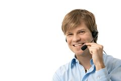 Happy young man talking on headset Royalty Free Stock Photography