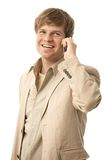 Happy young man talking on mobile Royalty Free Stock Photography