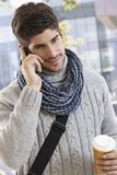 Happy young man talking on mobile outdoors Stock Images