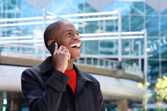 Happy young man talking on mobile phone Stock Photos