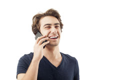 Happy young man talking on mobile phone Royalty Free Stock Images