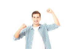 Happy young man in template t shirt isolated on white. Copy space. Mock up. Student Pass exam test. Happy young man in template t shirt isolated on white. Copy Stock Photos