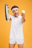 Happy young man tennis player inviting you to play Stock Photo