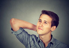 Happy young man thinking daydreaming looking up Royalty Free Stock Photography