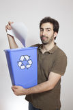 Happy young man throw paper in blue basket Stock Photo