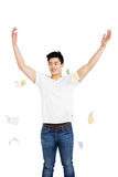Happy young man throwing currency note Stock Photos