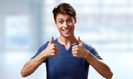 Happy young man with thumbs Royalty Free Stock Photo