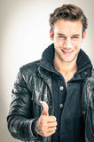 Happy young man - Thumbs up gesture. Happy young man with Thumbs up gesture Royalty Free Stock Photography