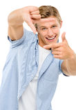Happy young man thumbs up isolated on white background Stock Image