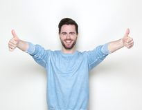 Happy young man with thumbs up Royalty Free Stock Image