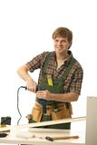 Happy young man tinkering Stock Images