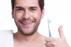 Happy young man with a toothbrush. Stock Photography