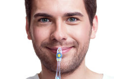 Happy young man with a toothbrush. Royalty Free Stock Image