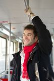 Happy young man traveling by subway Stock Image