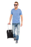 Happy young man with trolley bag Royalty Free Stock Photo