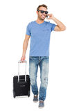 Happy young man with trolley bag Stock Photography