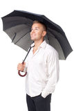 Happy young man under an umbrella Royalty Free Stock Image