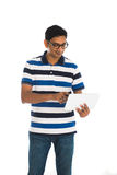 Happy young man using digital tablet Stock Photo