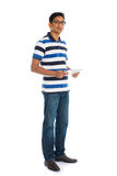 Happy young man using digital tablet Royalty Free Stock Images