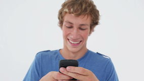 Happy young man using his cellphone Stock Photo