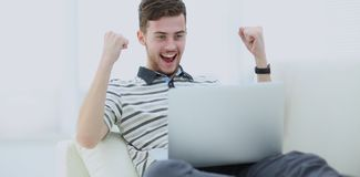 Happy young man using his laptop, Close up. Stock Photos