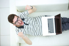 Happy young man using his laptop, Close up. Stock Photography