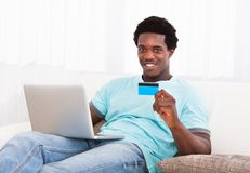 Happy young man using laptop Royalty Free Stock Image
