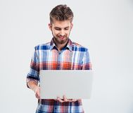 Happy young man using laptop Royalty Free Stock Images